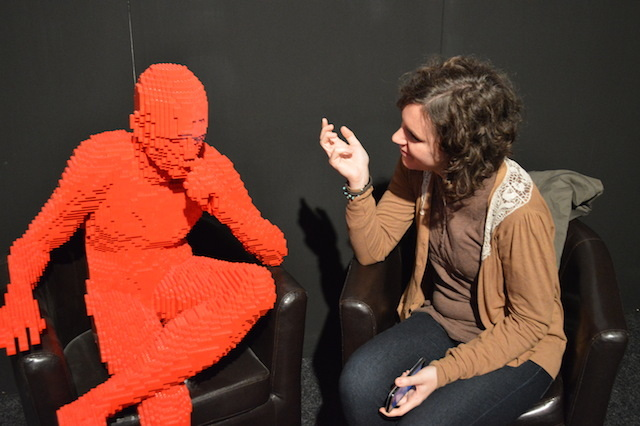 Londonist Silvia (she's the one on the right), interviews  Red Guy Sitting at the exit.