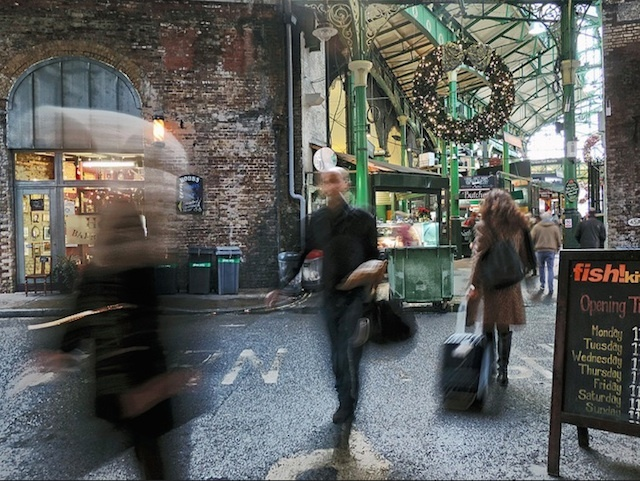 The hustle and bustle of Borough Market at Christmas time, photographed by Duncan Harris.