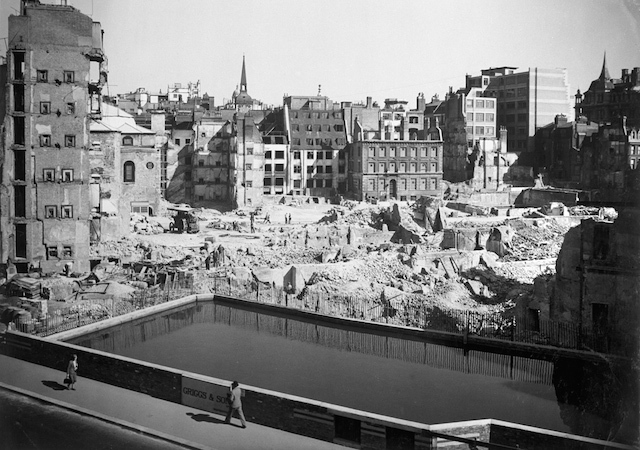 Emergency water supply at Queen Victoria Street. Looking across the emergency water supply in Queen Victoria street to Walbrook and Bond Court. To the left of the traction engine is St. Stephen's Church. Photograph by Arthur Cross / Fred Tibbs