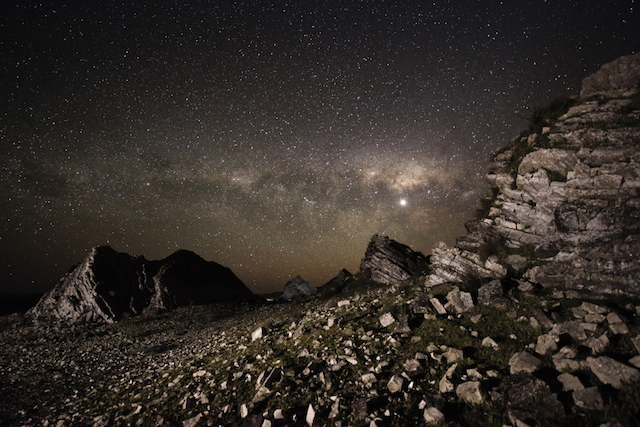 Rock formation in the Wairarapa district of New Zeland create a stark foreground and  contrast to the dusty clouds dancing acorss the Milky Way. No light pollution and a clear, crisp night afford the photographer a fantastic opportunity for this superb image