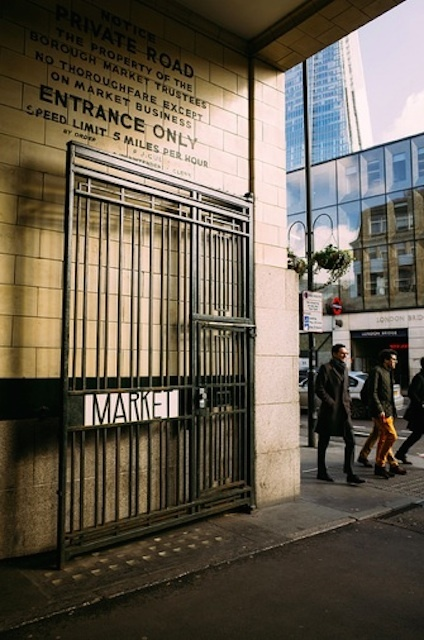 The side gate of the market, with the Shard peeking round the corner. By Laura McGregor.
