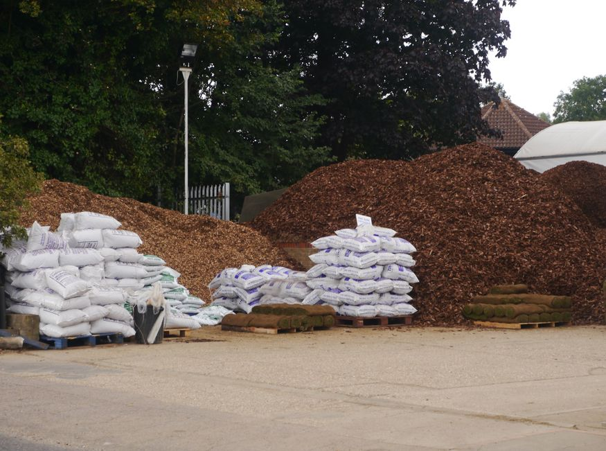 A mountain of mulch. Over the back diggers were ploughing into a huge pile of topsoil