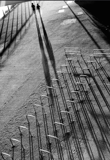 Shadowy cycle racks. Photo by Mark.