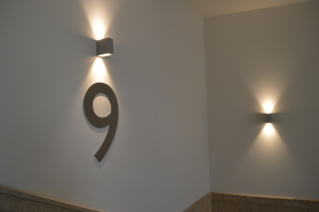 Much of the renovation concerned itself with restoring original features. New interventions, such as the floor numbers and lighting, are in complementary style. Indeed, the number font is Gill Sans, developed by Eric Gill who worked closely with the BBC.