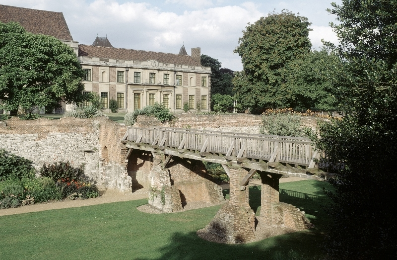Eltham Palace, the bridge over the dry moat with the House and gardens beyond.