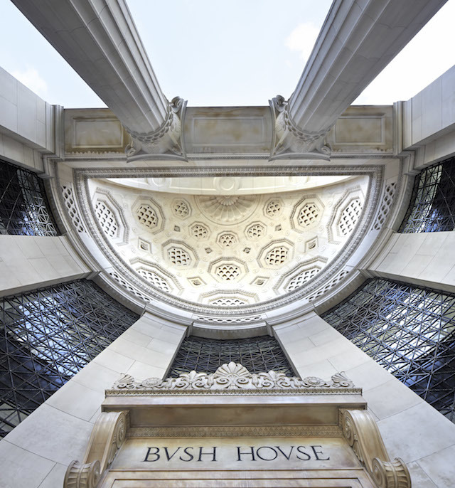 Looking up at the 'big business classicism' of the entrance niche. Courtesy of Hufton+Crow.