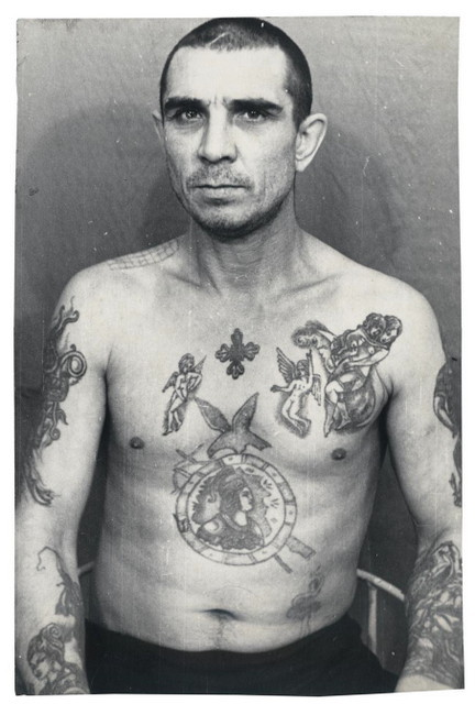 Police Files Print No. 1. Tattoos are status symbols in prison and this inmate has copied the tattoos of others to elevate his status. © Arkady Bronnikov / FUEL
