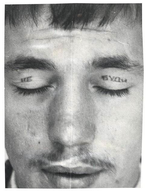 Police Files Print No. 7. Text reads 'Do not / Wake'. Eyelid tattoos are made by inserting a metal spoon under the eyelid so that the 'needle' doesn't pierce the eye. © Arkady Bronnikov / FUEL