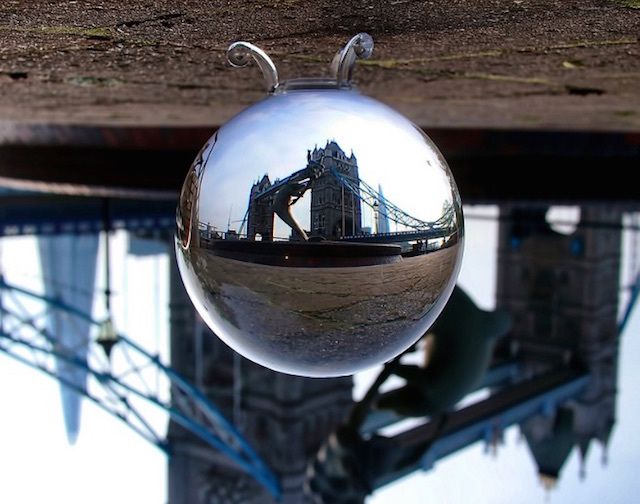 Girl with a dolphin statue seen through a crystal ball. Photo: Anatoleya