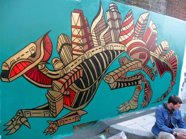 Andy Council painted Ouranosaurus at Street Fest in Shoreditch in 2011. Made out of London high rise buildings that are already in the City or going to be built there. Also featured is the bridge in Shoreditch and tube trains. Photo by Andy Council