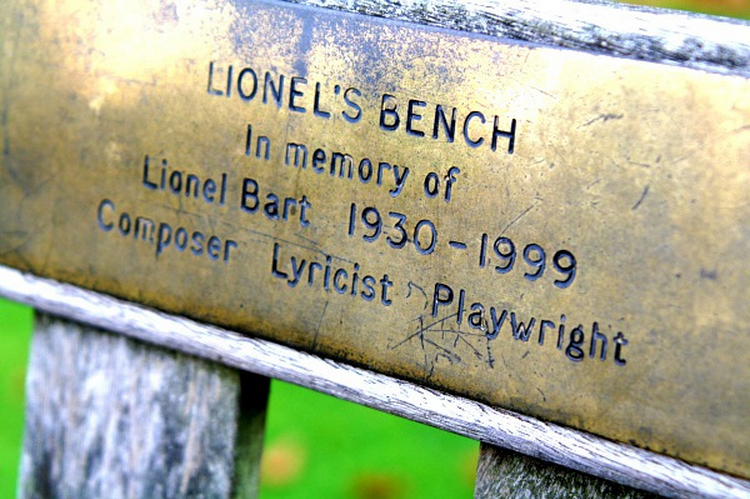 Lionel Bart gave the world such hits as From Russia With Love, the music for Oliver! and Cliff Richard's Living Doll, so memorably covered by fellow bench dedicatee Rik Mayall and the Young Ones. Bart's bench is in Kew Gardens, and is pictured here by Peter Denton in the Londonist Flickr pool.