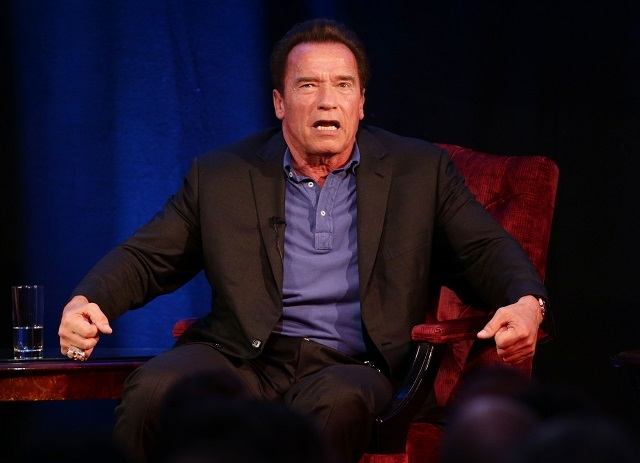 Arnold Schwarzenegger in conversation with host Jonathan Ross during 'An Evening with Arnold Schwarzenegger', at the Lancaster London Hotel in London. PRESS ASSOCIATION Photo. Picture date: Saturday November 15, 2014. Photo credit should read: Yui Mok/PA Wire