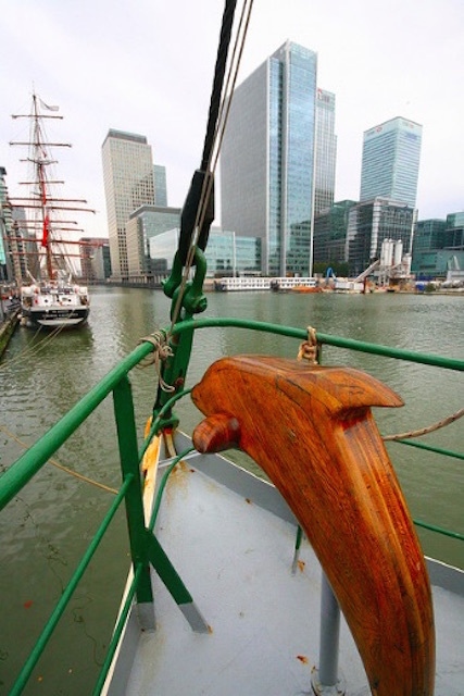 Dave the Dolphin overlooking Canary Wharf when Rainbow Warrior docked at Thames Quay in 2009. Photo: Treesiepopsicles
