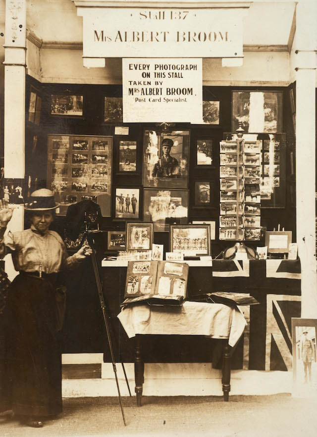 Christina Broom with her stall at the Women's War Work Exhibition, Princes' Skating Rink, Knightsbridge, 1916.