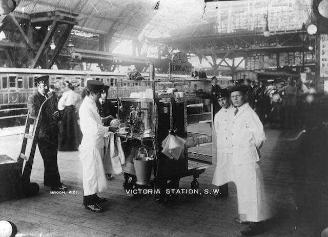 An early Broom photograph of a J. Lyons tea stall on the platform at Victoria Station, c.1905.