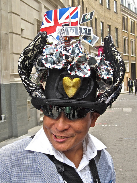 Man with Margaret Thatcher hat, by Andy Worthington