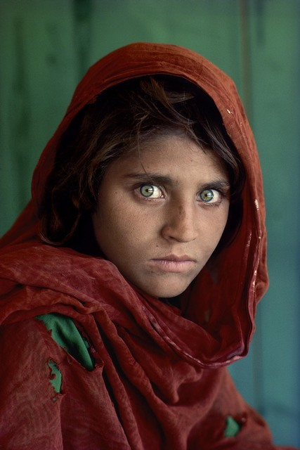 "Sharbat Gula, Afghan Girl, at Nasir Bagh refugee camp near Peshawar, Pakistan, 1984.National Geographic Magazine, Vol. 167, No. 6, June 1985, Along Afghanistan's War-torn Frontier.""The green-eyed Afghan girl became a symbol in the late twentieth century of strength in the face of hardship.  Her tattered robe and dirt-smudged face have summoned compassion from around the world;  and her beauty has been unforgettable.  The clear, strong green of her eyes encouraged a bridge between her world and the West.  And likely more than any other image, hers has served as an international emblem for the difficult era and a troubled nation."" - Phaidon 55The iconic image does not stand outside of time.  Rather, it connects with the moment in a deeply profound way.  Such as images are imbued with meaning, a significance that resonates deeply with a wide and diverse audience.  McCurry's photograph of the Afghan girl is one such image.  For many, this beautiful girl dressed in a ragged robe became a worldwide symbol for a nation in a state of collapse.  Haunted eyes tell of an aAfghan refugee's fears. Bannon, Anthony. (2005). Steve McCurry. New York: Phaidon Press Inc., 12.NYC5958, MCS1985002 K035Afghan Girl: FoundNational Geographic, April 2002Iconic PhotographsNational Geographic Magazine, Along Afghanistan's War-torn Frontier, June 1985, Vol. 167, No. 6South Southeast_BookIn the Shadow of Mountains_BookSteve Mccurry_BookLooking East_BookIconic_BookUntold_bookPORTRAITS_APPfinal print_MACROfinal print_Sao Paulo final print_Milan final print_Birmingham Retouched_ Sonny Fabbri 4/8/2014"