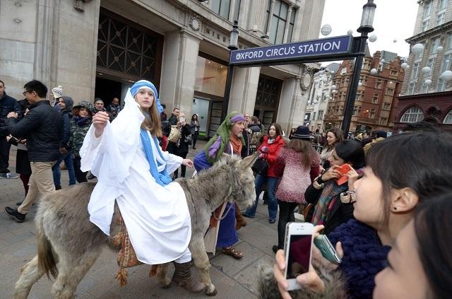 The Wintershall Players, Nativity cast with donkey  24th November 2013 Chester (donkey) Rachel Burdon (Virgin Mary) Tim Hendy (Joseph)   Photo by Justin W Thomas