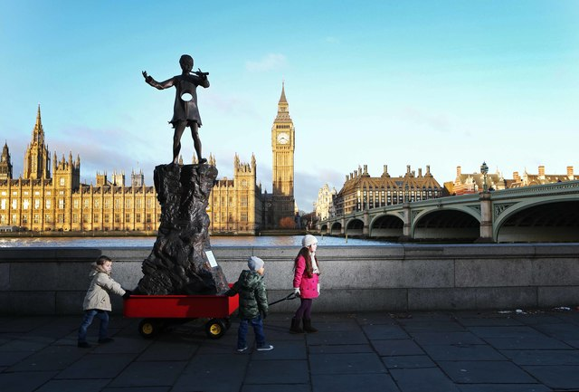 "A group of little ones, accompanied a replica of the iconic Peter Pan statue to a position on the Albert Embankment, overlooking the Houses of Parliament.  The statue, adapted to feature a large hole in place of his tummy, has been commissioned by Ella's Kitchen to urge all MPs not to ignore the importance of early childhood nutrition.  The placing of the statue in this location represents a final push in the aims of the Averting a Recipe for Disaster report.  Published in 2012 the report asked the 3 main parties to recognise the importance of early childhood nutrition by committing in their upcoming election manifestos to appointing a Government Advisor to coordinate an independent review of health, nutrition + food education for the under-fives.   Supporting information for IPTC Britain is facing a health crisis. One in three of today's children are overweight or obese and in stark contrast malnutrition is on the rise. The future health of our nation rests on the nutrition of today's youngest children.   Support our call for a 'Food Manifesto for the Under Fives' and help avert a disaster by sharing: ""I support the #KidsFoodManifesto"""