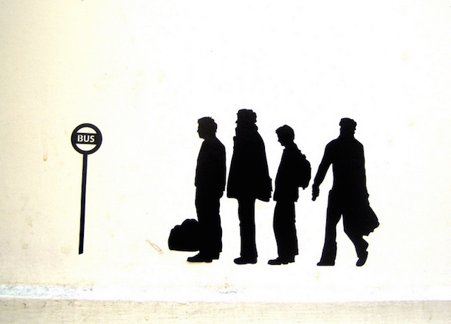Stencilled street art of a bus stop queue. Photo: Annie