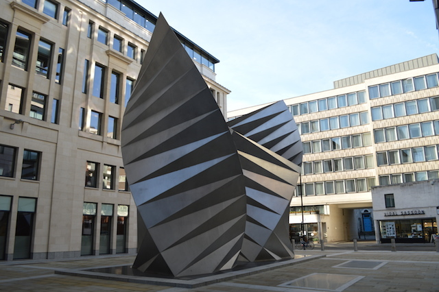 Also in Paternoster Square, these metallic wing structures were designed by the all-conquering Thomas Heatherwick (Garden Bridge, New Routemaster, Olympic cauldron, etc. etc.). They serve as cooling vents and radiators for a subterranean electricity substation. Image by M@.