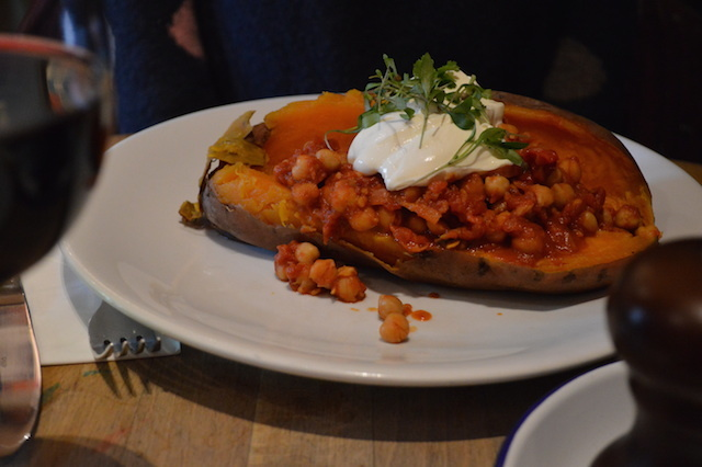 Veggie option. A massive, and we mean massive, sweet potato, bedecked with chickpea stew.