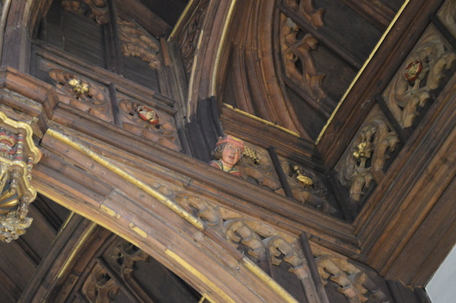The hammerbeam ceiling contains numerous painted faces. It is said that these were positioned in the eaves to remind courtiers that their conversations might be overheard - the origin of the word 'eavesdropping'.