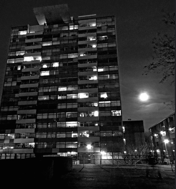 The moon hovers behind the Golden Lane Estate tower block in the City. Photo: EZTD