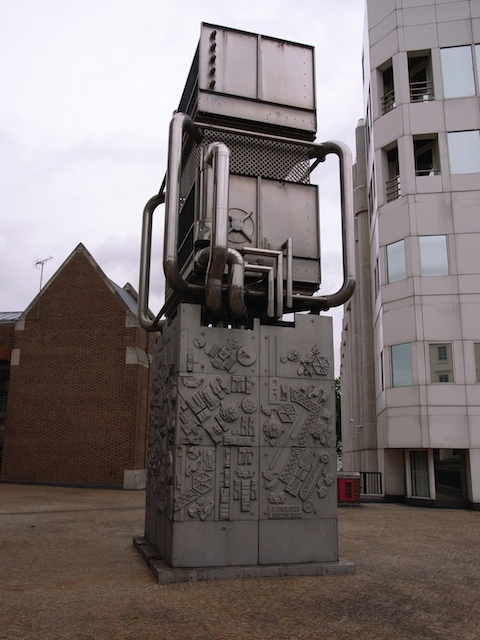 Sir Eduardo Paolozzi made many contributions to London, including the currently topical Tottenham Court Road mosaics, and the statue of Newton outside the British Library. One of his more understated works, from 1982, can be found outside Pimlico station -- a grey ventilation pipe decorated with his usual melange of mechanical motifs. Image by Steve Cadman under Creative Commons copyright.