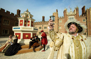 Photography by Richard Lea-Hair. 29/04/2010. richard@leahairphotography.com TEL - 07767 308688.  Henry VIII and members of his court enjoy a Tudor wine fountain recreated at Hampton Court Palace, ahead of the May Day Bank Holiday weekend. Standing at over 4 metres tall, constructed from authentic materials including timber, lead bronze, and embellished with gold leaf, the fountain will run with red and white wine on weekends and bank holidays.  *****FREE EDITORIAL USAGE***** FOR FURTHER INFORMATION CALL RUTH HOWLETT AT HISTORICAL ROYAL PALACES  - 0203 1666338