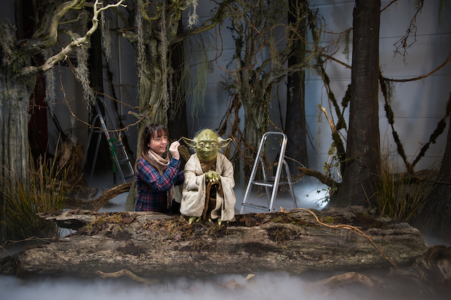 The finishing touches are put to a wax model of Yoda in preparation for the May opening of the new Star Wars experience.