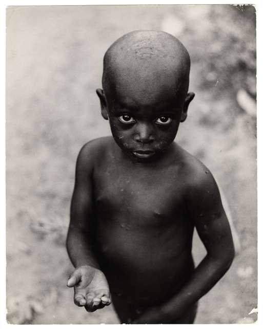 This starving, begging child in Biafra (now Nigeria) is one of many images with a heavy emotional impact on the viewer. Carlo Bavagnoli, 1968.