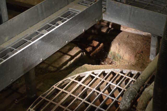 A tributary of the River Tyburn in a culvert, with a pump. Photo: Sandra Lawrence.