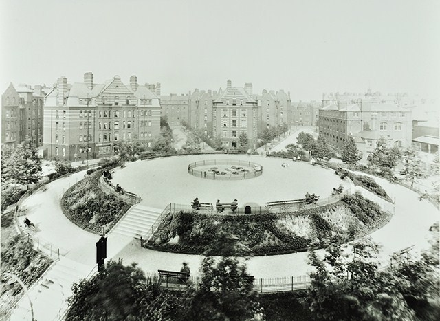 The estate is nearing completion by 1903, with only the bandstand still to be added. A 2009 Museum of London excavation (PDF) proved that the central mound was raised from the rubble and left-behind items of the former slums. Image from London Metropolitan Archives, City of London.