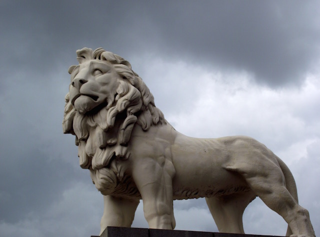 "The Coade Stone Lion. This magnificent beast first adorned a Thames side brewery in 1837. He has been standing proudly at the southern end of Westminster Bridge since 1966. Coade Stone was an artificial ceramic produced to a ""secret formula"". The Lion's plinth has a bit part in the Bond film, Die Another Day, as a secret entrance to a tube station."