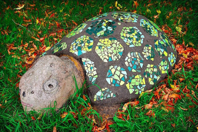 This tiled creature sits in Robin Hood Gardens in Poplar. Photo: Compound Eye (2014)