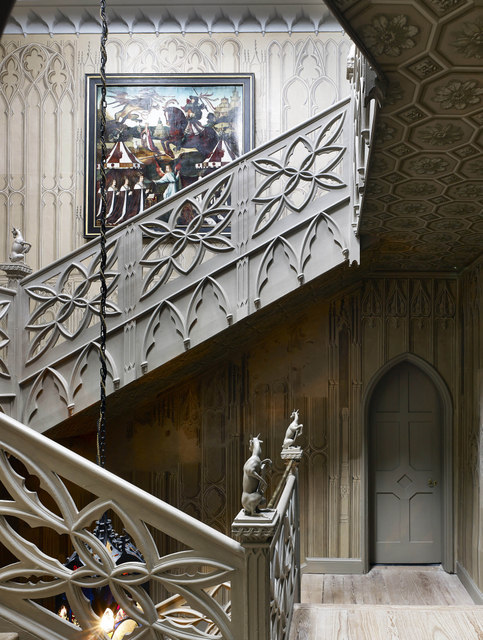 This intricately carved staircase greets visitors as they enter the house.