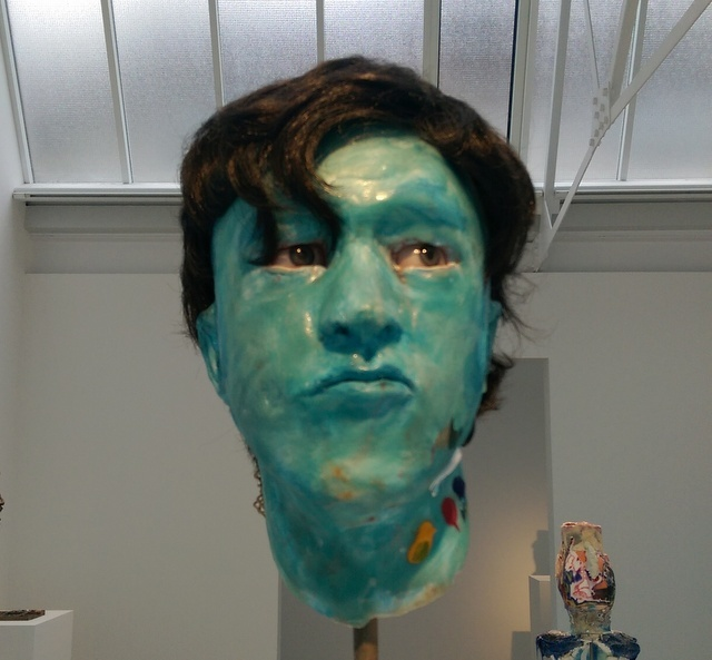This blue green coloured head is one of the more traditional works on display. Copyright David Altmejd, photo Tabish Khan