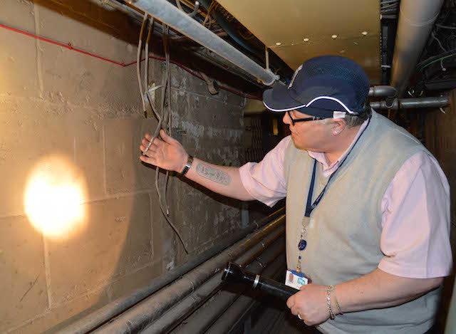 Steve Staley inspects original cabling. Photo: Sandra Lawrence.