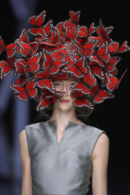 Butterfly headdress of hand painted turkey feathers Philip Treacy for Alexander McQueen, La Dame Bleu,Spring/Summer 2008. Copyright Anthea Sims