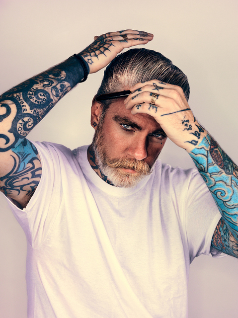 Tattoo artists Miles Better  sports one of many well groomed beards in this exhibition.  © Mr Elbank