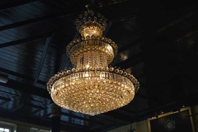 The central chandelier, like a fulgent sun in its own right.