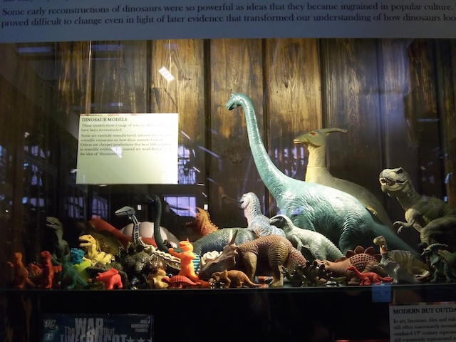 A collection of dinosaur toys shows the iconic way in which they are represented to us - yet tyrannosaurus is now thought to have been feathered.