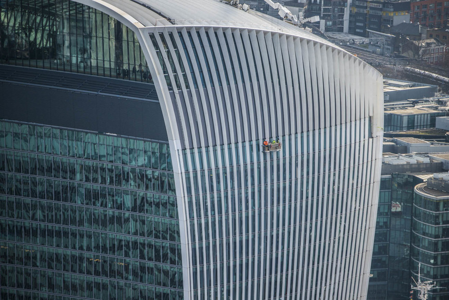 Window cleaners dangling off the side of 20 Fenchurch Street.