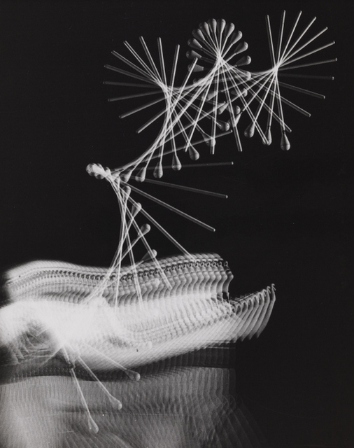 60 exposures over a second capture the flight of a baton. © Harold Edgerton