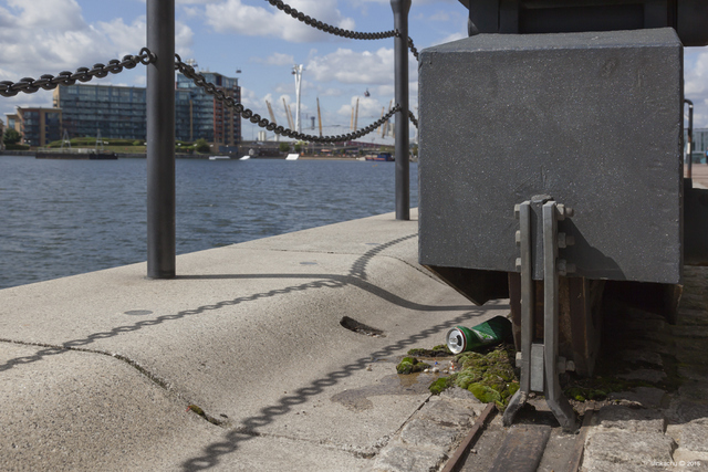 Next to the base of one of the gargantuan cranes in Royal Victoria Docks. Copyright Slinkachu