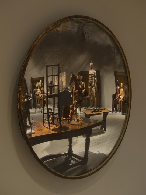 These mirrors surround the exhibition, casting a distorted view. Photo: Robert Keziere
