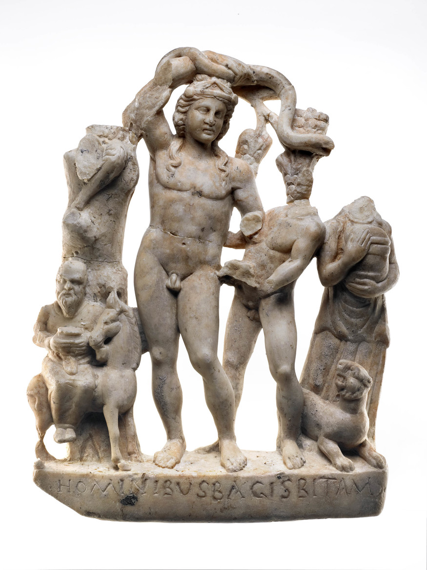 Bacchus group from the Temple of Mithras. The sculpture is made of carrara marble and depicts Bacchus with Silenus, a satyr, maenad and a panther. This sculpture was found on the latest floor of the temple when the building was no longer used to worship Mithras. It was located at the east end of the temple, against the North wall.