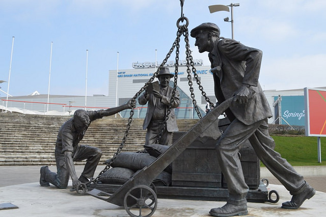One of our favourites, the Dockers Sculpture lurks beside the ExCel centre at Royal Victoria Docks. The three workers represent actual people: John Ringwood, a former seaman; stevedore Patrick Holland; and Mark Tibbs of Canning Town.  It's by Les Johnson and stands about three metres high.