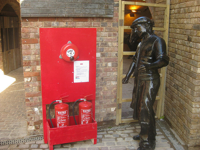Stables Market in Camden Town is overcrowded with sculptures depicting farriers, blacksmiths, horses and - shown here - fire extinguisher inspectors.